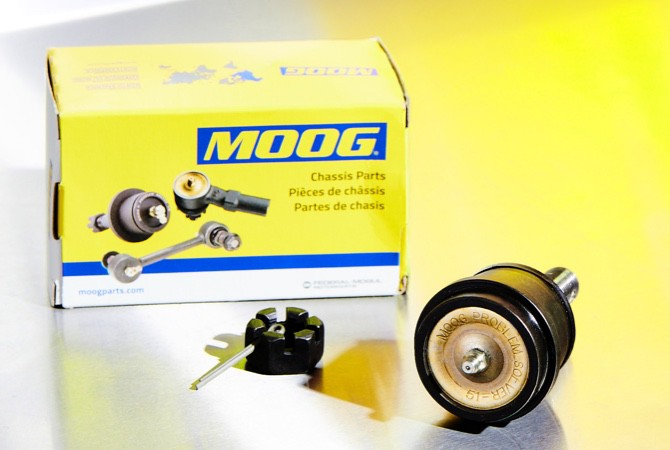 A MOOG chassis parts box next to a MOOG ball joint
